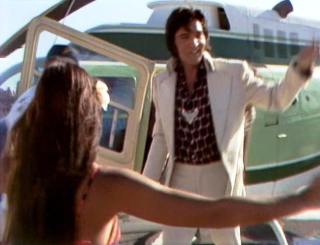 Elvis exiting the helicopter being greeted by all of his adoring fans!